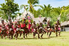 Seniors doing impressive dragon dance ceremony, Kopar village, Sepik River, Papua New Guinea