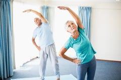 Seniors doing stretching Stock Photos