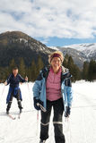 Seniors doing winter sports royalty free stock photo