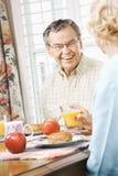 Seniors eating breakfast royalty free stock photos