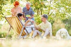 Seniors eating and drinking during a picninc Stock Photo