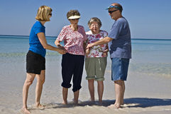 Seniors Enjoying the Beach Stock Photography