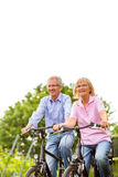 Seniors exercising with bicycle Royalty Free Stock Photos