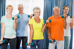 Seniors exercising with weights Stock Photography