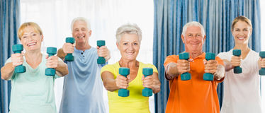Seniors exercising with weights Royalty Free Stock Photo