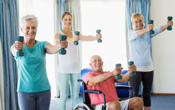 Seniors exercising with weights Stock Image