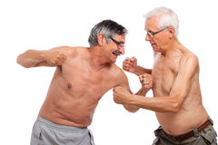 Seniors fight. Naked seniors fighting, isolated on white background Royalty Free Stock Images