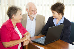 Seniors and Financial Advisor. Seniors discuss their retirement with a financial advisor Stock Photo