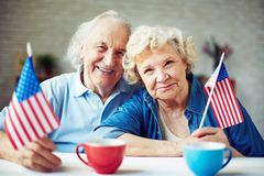 Seniors with flags Stock Photography