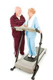 Seniors Flirting at the Gym. Senior man flirting with a senior woman at the gym.  Full body isolated on white Stock Photos