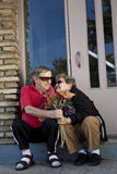 Seniors flirting offering flowers royalty free stock photos