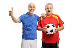 Seniors with football and thumb up gesture Royalty Free Stock Image