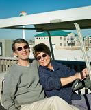 Seniors in Golfcart at the Beach Royalty Free Stock Images