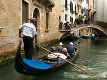 Seniors On The Gondola. Seniors in the venetian gondola in italy Stock Photo