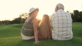 Seniors and grandchild on nature background. stock video footage