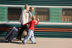 Seniors with grandson on station stock image