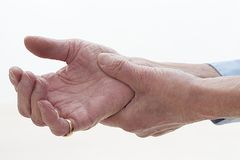 Seniors hands with pain Stock Photo