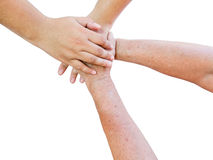 Seniors hands and young hands in unity on white background Royalty Free Stock Photo