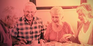 Seniors having lunch together stock photography