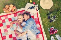 Seniors having a picnic Stock Photo