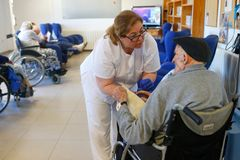Seniors and nurse during their daylife on a nursing home in Mallorca royalty free stock photography