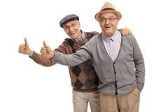 Seniors holding their thumbs up Stock Photography