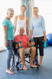 Seniors holding weights Royalty Free Stock Photos
