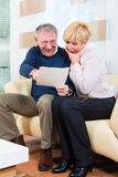 Seniors at home receiving a good letter Stock Photos