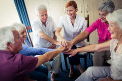 Seniors interacting with nurse. In the retirement house Stock Images