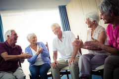 Seniors interacting. In the retirement house Stock Photography