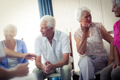 Seniors interacting. In the retirement house Royalty Free Stock Images