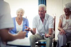 Seniors interacting. In the retirement house Stock Image