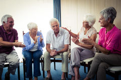 Seniors interacting. In the retirement house Royalty Free Stock Image