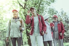 Seniors interested in hiking in the natural reserve. Spending time actively. Seniors interested in hiking in the natural reserve stock photo
