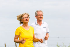 Seniors jogging in the nature Stock Images