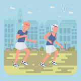 Seniors jogging by the street Royalty Free Stock Image