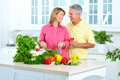 Seniors at kitchen royalty free stock photo