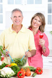 Seniors at kitchen. Happy seniors couple cooking at kitchen royalty free stock photography