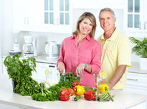 Seniors at kitchen. Happy seniors couple cooking at kitchen Royalty Free Stock Image