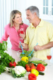 Seniors at kitchen. Happy seniors couple cooking at kitchen royalty free stock photo