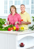 Seniors at kitchen Stock Photography