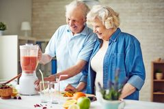 Seniors in the kitchen Royalty Free Stock Images
