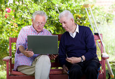 Seniors with laptop Stock Images