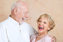 Seniors Laughing Together. Senior couple in love, still make each other laugh Royalty Free Stock Photography