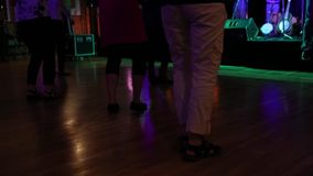 Seniors line dancing in community hall
