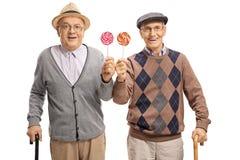 Seniors with lollipops Stock Image