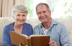Seniors looking at their photo album Royalty Free Stock Image