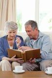 Seniors looking at their photo album Royalty Free Stock Photo