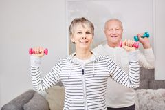 Seniors making fitness exercise Royalty Free Stock Image