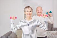 Seniors making fitness exercise Royalty Free Stock Image